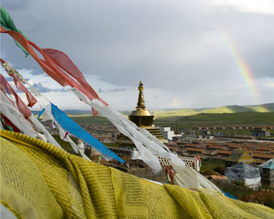 prayer flags, stupa and rainbow Tibet Spring Brook Ranch