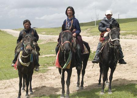 Mongolian nomads on horseback