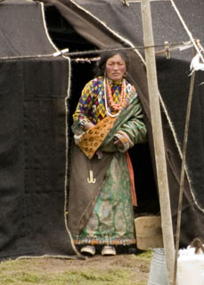 Tibetan nomad woman in front of black tent